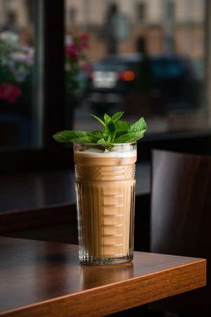 Cold coffee with ice and mint in a cafe, cold coffee cocktail with mint Reklamní fotografie