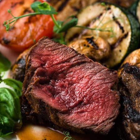 Medium Grilled bbq steaks, steak with blood