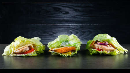 set collection three low-carb Burger, Protein lettuce wrapped burger lettuce wrap with toppings and copyspace Reklamní fotografie