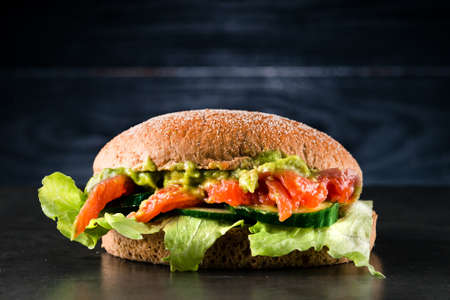 Homemade Toast sandwich with Salmon. healthy food salmon and guacamole sandwich Reklamní fotografie