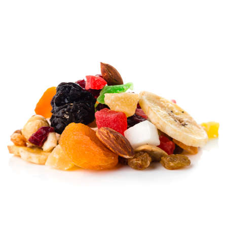Mix nuts and dry fruits on a white background