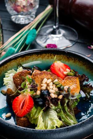 Fried foie gras luxury dish in a black bowl Reklamní fotografie