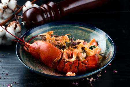 a luxury dish of lobster roasted and decorated with many items of vegetable Reklamní fotografie