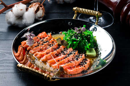 smoked salmon with Chuka salad top view, Raw Organic Poke Bowl with with salmon, chuka salad close-up on wooden background Reklamní fotografie