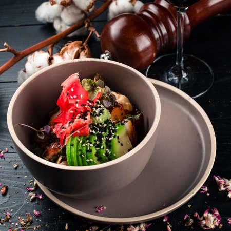 Japanese cuisine food. Poke bowl with ginger, avocado and shrimp