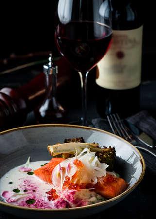 Pan fried Salmon, A large steak of grilled red fish fillet salmon served in a restaurant. European cuisine. Reklamní fotografie