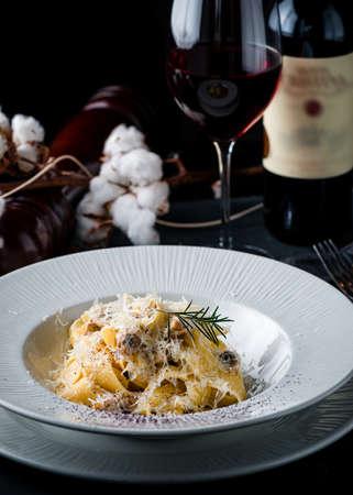 pasta linguine with parmesan cheese, dark background, pasta on a dark background Reklamní fotografie