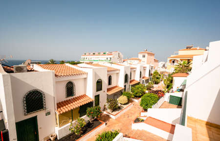 Elevaterd view of apartments and townhouses in the town centre, Spanish town house middle-class housing Reklamní fotografie