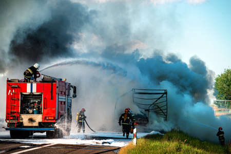 firefighter extinguishes a burning car after an accident, fireman using water and extinguisher car is on fire, Firefighter using extinguisher for fire fighting, burning car Gas