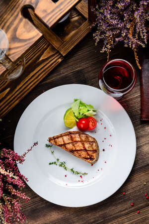 Barbecue tuna steak closeup on a plate. steak tuna grill bbq top view, flat lay