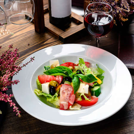 Salad with fresh summer vegetables, top view salad rustic stile