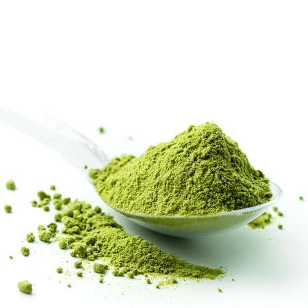 Heap of green matcha tea powder on white background, powdered hill green tea isolated
