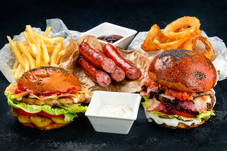 fast food collection on wooden table background. Unhealthy food concept, fast food set with burgers and fries