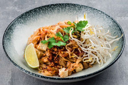 Chicken pad Thai dish of stir fried rice noodles, Pad Thai with chicken 免版税图像