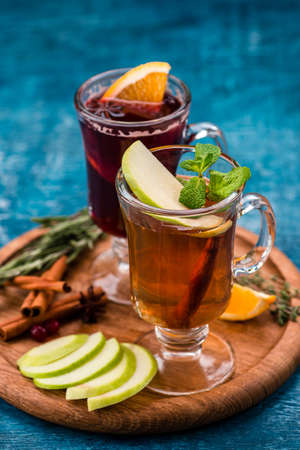 Spicy hot tea with apple and orange, cinnamon, star anise, Christmas drink Mulled cider with cinnamon, anise and apple