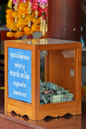 Donation Box with Thai Baht Banknote