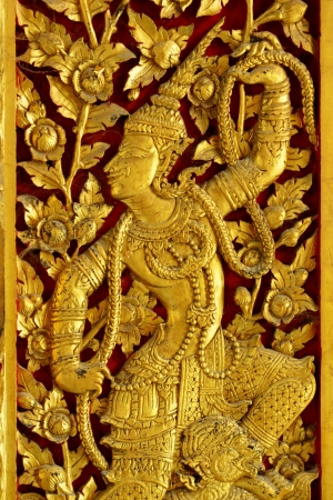 Thai woodcarving angle painted with golden color a;ways found at temple or palaces door photo