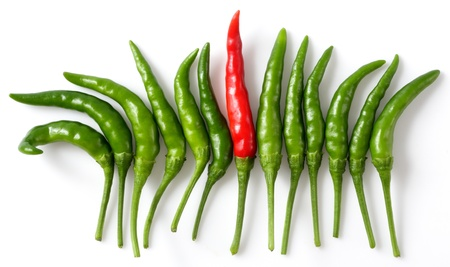 Outstanding red pepper among green pepper (Bird Chilli or Thai pepper) photo
