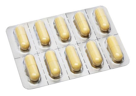 Yellow capsules in aluminium foil strips Stock Photo - 16309359