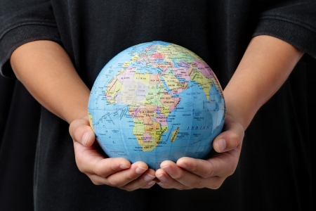 Save the Earth : Globe in two palm hands Stock Photo - 16309467