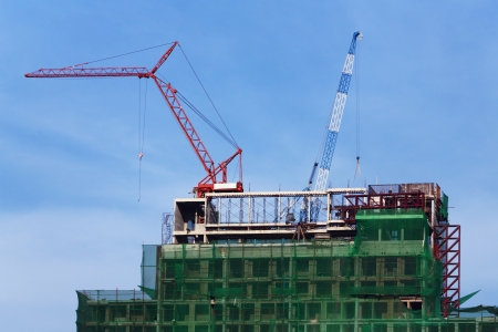 Building crane working on top of the building Stock Photo - 16309513