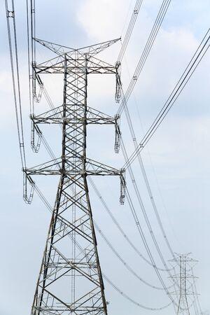 High voltage electricity pylon and blue sky photo