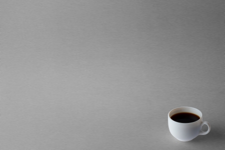 Coffee cup isolated on metalic background photo