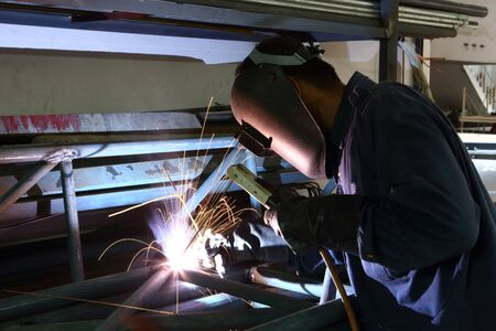 Worker welding iron frame structure Stock Photo - 16723573