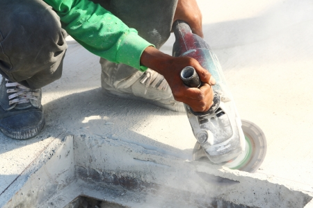 grinder machine: Worker use angle grinder to cut concrete Stock Photo