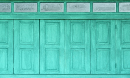 Green color wood windows with glass photo