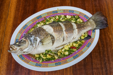 Steamed sea bass with lemon, chili and garlic sauce Stock Photo - 17096162