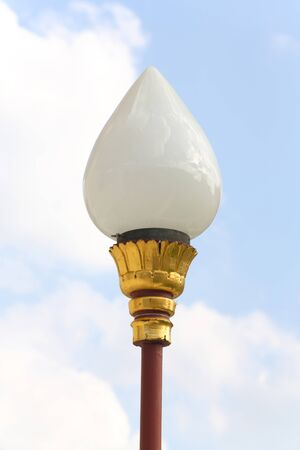 Elegance street lamp isolated on sky photo