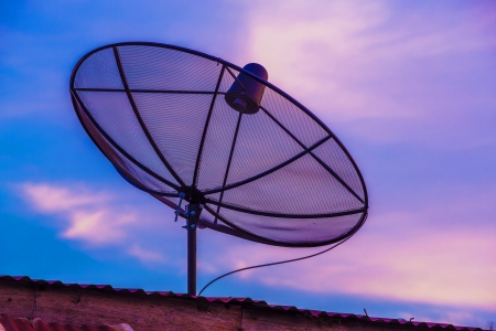 Television Satellite dish in twilight sky Stock Photo - 17096161