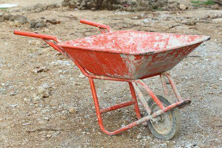 Thai red color construction wheelbarrow in site Stock Photo - 17096159