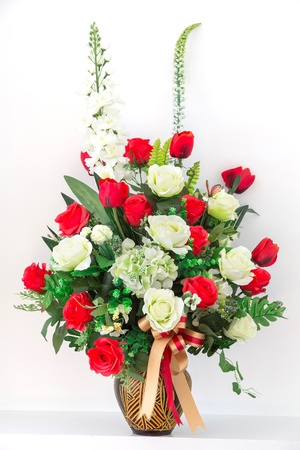 Bouquet of red and white roses in a vase photo