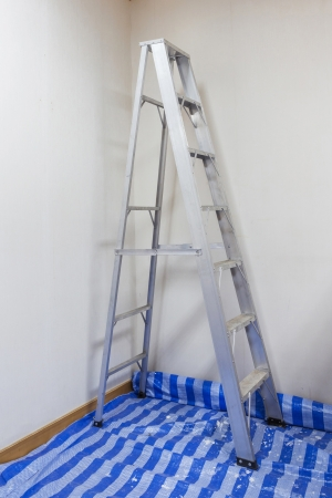 Aluminum Ladder for repair air duct above ceiling photo