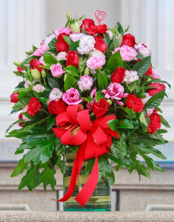 Bouquet of flowers in a glass vase photo