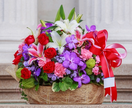 Basket of flowers with namecard tag photo