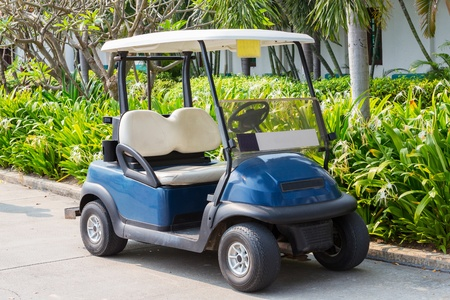 Golf cart or club car at golf course photo