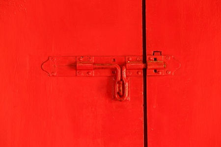 Red door with red bolt photo
