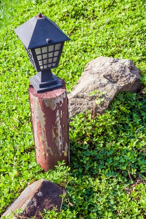 Garden lamp in morning sunlight photo