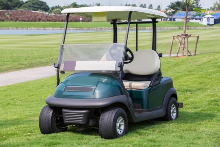 Carrito de golf o un autom�vil club de golf photo