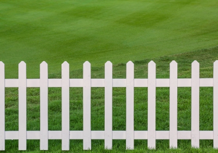 Green lawn and white wood fence Stock Photo - 17304592