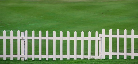 Green lawn and white wood fence Stock Photo - 17304443