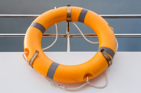 Orange life buoy in boat photo