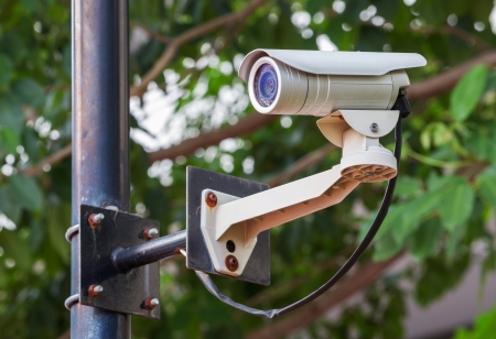 White CCTV camera watching for security 24 hours Stock Photo - 17304517