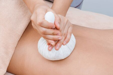 Herbal compress ball massage in Thai spa photo