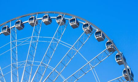 White ferris wheel in blue sky photo