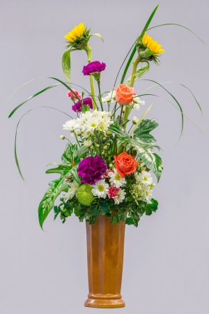 bouquet of flowers in a ceramic vase photo