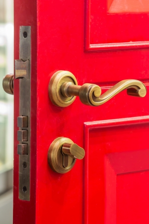 Red color wooden door with brass bolt photo